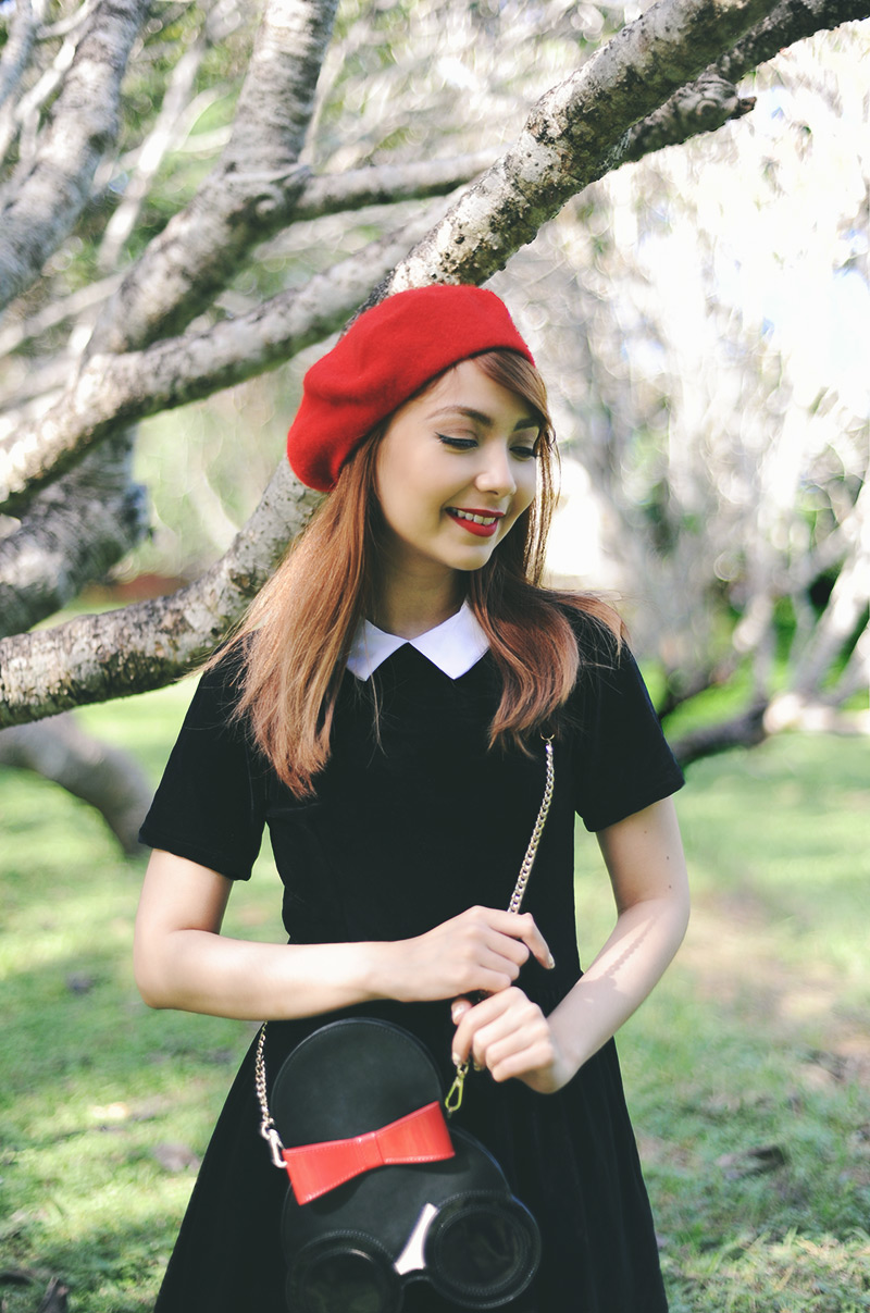 black velvet dress and red beret